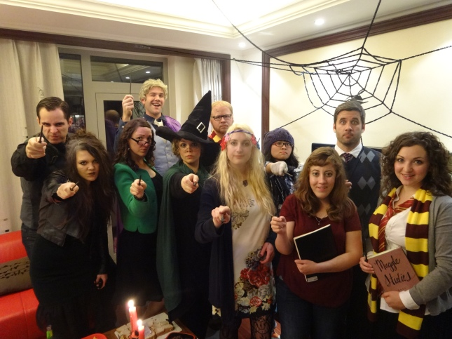 Characters from left to right. (front row): Professor Snape (Justin), Bellatrix LeStrange (Cat), Rita Skeeter (me), Professor McGonagall (Heather), Mundungus Fletcher (Abigail), Ginny Weasley (Nicole), and Hermione Granger (Kate). (Back row): Draco Malfoy (Justin), Gilderoy Lockhart (Warren), Harry Potter (Erik), Luna Lovegood (Rosana), and Ron Weasley (Trent).